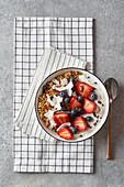 Vegan muesli, fruit and yoghurt bowl