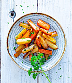 Colourful roasted carrot sticks with parsley