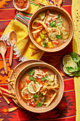 Mexican soup with tortillas and lime
