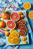 Various citrus fruit - mandarine, pink graefruit, kumquat, orange and blood orange