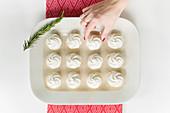 Tray of white cupcakes