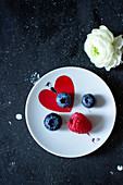 Fresh berries on a plate with a heart