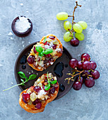Bruschetta with grapes, nuts and balsamic vinegar