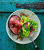 Roast beef with chestnuts and a mixed leaf salad