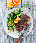 Rump steak with roasted asparagus and orange