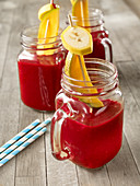 A beetroot smoothie with fruit skewers