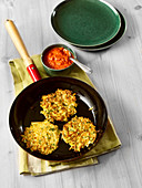 Parsnip fritters with tomato sauce
