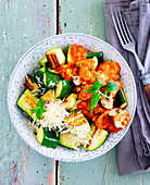 Roasted courgettes with Parmesan and a tomato medley
