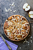 Apple and frangipane tart with almond flakes