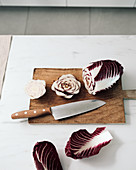 Radicchio with a knife on a wooden board