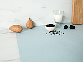 Sweet potatoes, black lentils, blackberries and a glass of yoghurt
