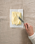 Butter being spread with a knife