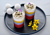 Vegan layered desserts in glasses with stick rice balls and sesame seeds