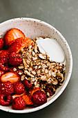 Cashew nut cream with fresh berries and granola