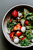 Strawberry and cucumber salad with pistachio nuts