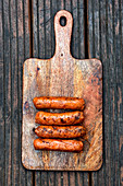 Vegan sausages on a wooden board