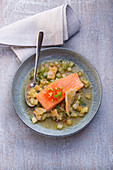 Salmon confit in a fennel sauce with bread and olives