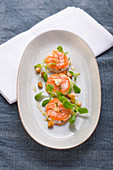 Salmon medallions with croutons and lambs lettuce