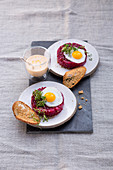 Beetroot tartare with a fried quail's egg and Sauce Hollandaise