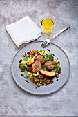 Quail's breast with peaches and lentils