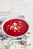 Beetroot cream soup with feta cheese and walnuts