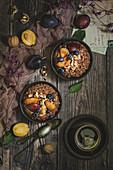 Chocolate porridge with caramelized plums