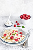Pancakes with vegan coconut cottage cheese and raspberries