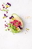 Avocado boat with beetroot hummus and petals