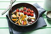 Roasted potatoes with vegetables, mushrooms and vegan yogurt dressing
