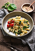 Pasta with garlic oil, spinach and grilled tomatoes