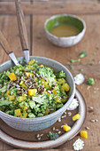 Raw broccoli and yellow pepper salad with apples and sunflower seeds