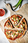 Gluten-free sourdough pizza with asparagus halloumi bacon and tomato sauce
