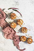 Vegan and glutenfree pumpkin muffins with coconut flakes