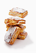 Puff pastry pockets with cherry jam and powdered sugar