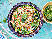 Vegetable risotto with pak choi leaves