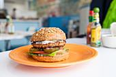 Vegan burger - beyond meat veggie patty, vegan mayo, pickles, grilled onion, lettuce, tomato
