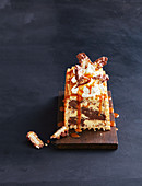 Ice cream cake with waffles and caramel sauce