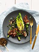 Lettuce with grilled asparagus , mushroom and serrano ham
