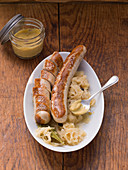 Thuringian bratwurst with sauerkraut and mustard