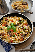 Farfalle with vegetables and mushrooms