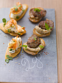 Crostini with lamb and shrimp