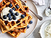 Stacked cheesecake waffles with blueberries