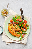 Salmon cutlet with spinach salad