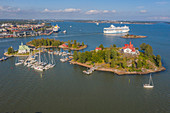 Islands, boats and a cruise ship off the coast of Helsinki, Finland