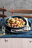 Gigli pasta with cured ham, pecan nuts, apple, rosemary and whisky