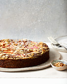 Almond and nut cake with peaches