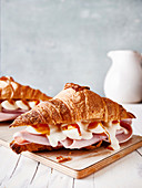 Croissants with cooked ham, boiled eggs and mayonnaise