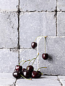 Cherries on and in front of stone wall