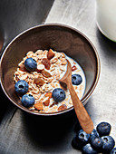 Muesli made from oatmeal, raisins, almonds, blueberries and milk