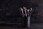 Purple asparagus in a metal can